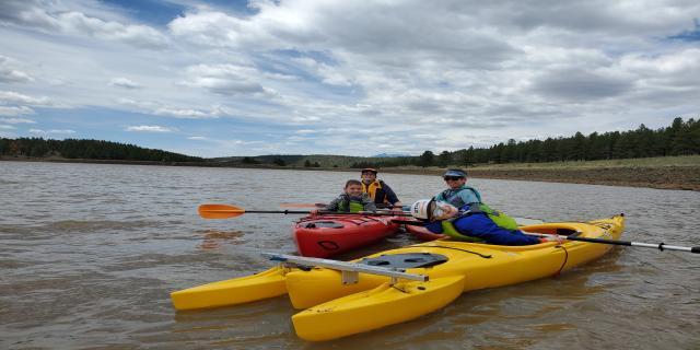 A family on the water in kayaks in Flagstaff Arizona
