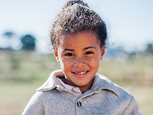 Girl in grey jacket smiling