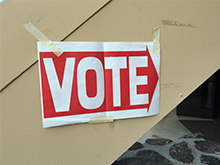 An Arrow posted on a wall that says Vote